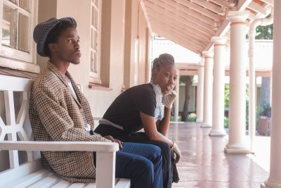 Qhawe Vumase & Philisiwe Ntintili waiting for passes to be stamped. Photo taken by Luke MacDonald.